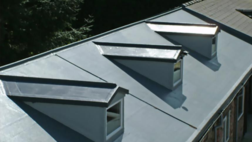 a pitched rubber roof that has been installed by our team