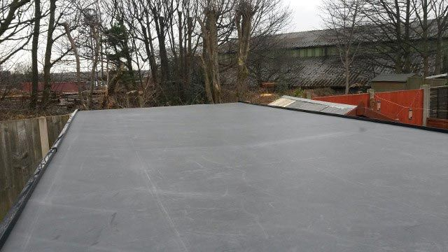 A flat rubber roof that has been installed by our team