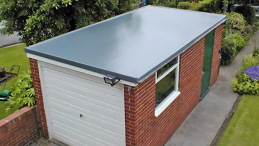 A flat garage roof installed by our team